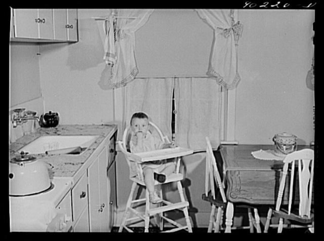 Mary K. Ratcliff, daughter of defense worker, in the kitchen of their home. Sunset Village, FSA (Farm Security Administration) project. Radford, Virginia