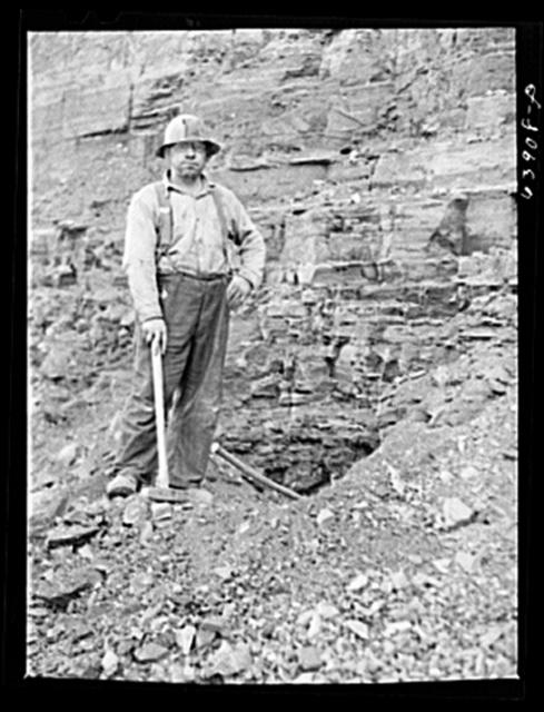 Member of blasting crew at Albany Mine near Hibbing, Minnesota