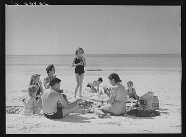 Members of Sarasota trailer park, Sarasota, Florida, picnicking at the beach