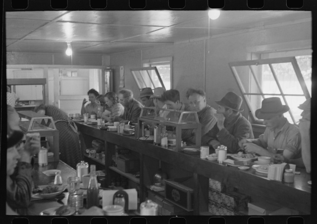 Men who work on mechanical hop picking machines have lunch at the company restaurant, Yakima Chief Hop Ranch, Yakima County, Washington