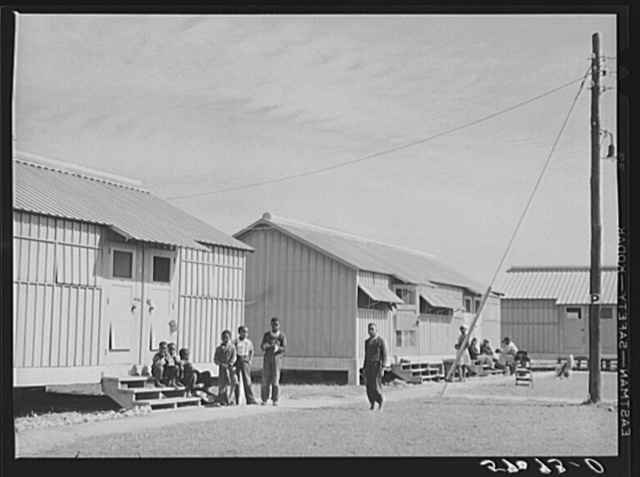Metal shelters for migratory vegetable pickers. Okeechobee migratory labor camps built by FSA (Farm Security Administration). Belle Glade, Florida