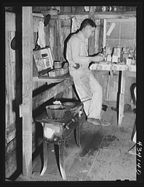 Migratory worker employed at Fort Bragg living in this old barn near Manchester, North Carolina