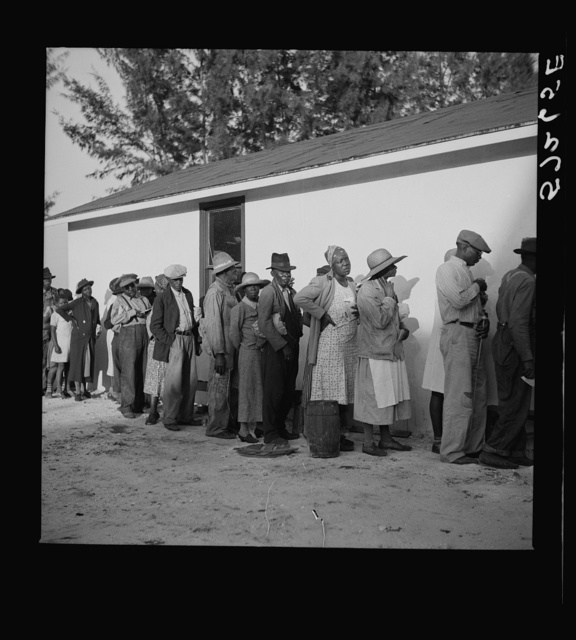 Migratory workers waiting to receive supplies of surplus commodities. Belle Glade, Florida