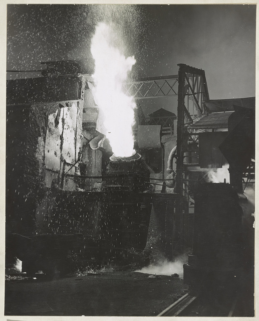 Molten iron is blown in an Eastern Bessemer converter to change it to steel at the Repubic Steel Corporation, Youngstown, Ohio