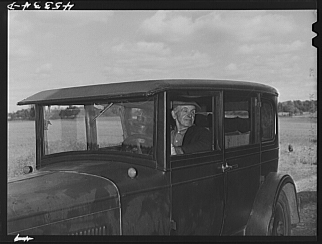 Mr. Herbert Alton, a neighbor, helps Mrs. Earl Barbour move from her home in the Pine Camp expansion area to nearby Evans Mills, New York. Alton himself will soon pack up and move to Syracuse, New York. Near Pine Camp, New York