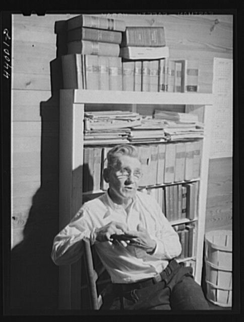 Mr. J. H. Parham, barber and notary public, in his shop in Centralhatchee, Heard County, Georgia