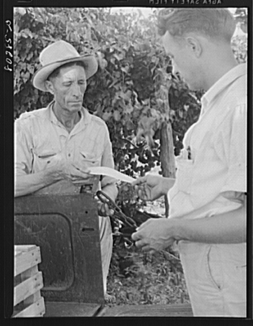 "Mr. James F. Drigger received a check for his chickens raised under the FSA (Farm Security Administration) ""Food for Defense"" program. Coffee County, Alabama"