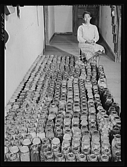 Mrs. Gus Wright, FSA (Farm Security Administration) client, with her canned goods. Oakland community, Greene County, Georgia