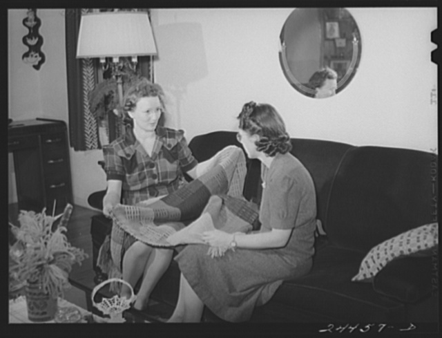 Mrs. Hardeman showing hand-woven curtains to Mrs. Golden, who also works at weaving shop. Dailey, West Virginia