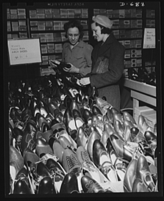 Mrs. Herbster shops for shoes. They have not increased in price she finds despite huge Army orders. The Consumer Division suggested the Army use composition soles for Army shoes when it was discovered that sole leather was going up