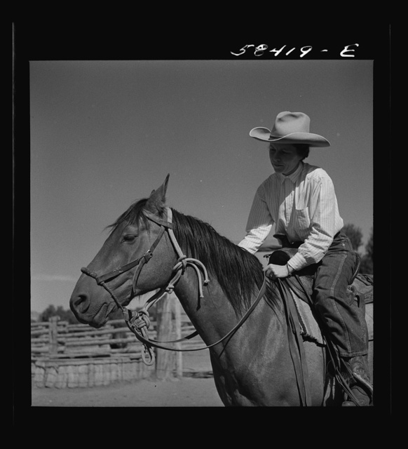 Mrs. Lyman Brewster on a ranch horse. In the corral at Quarter Circle U Ranch. Birney, Montana