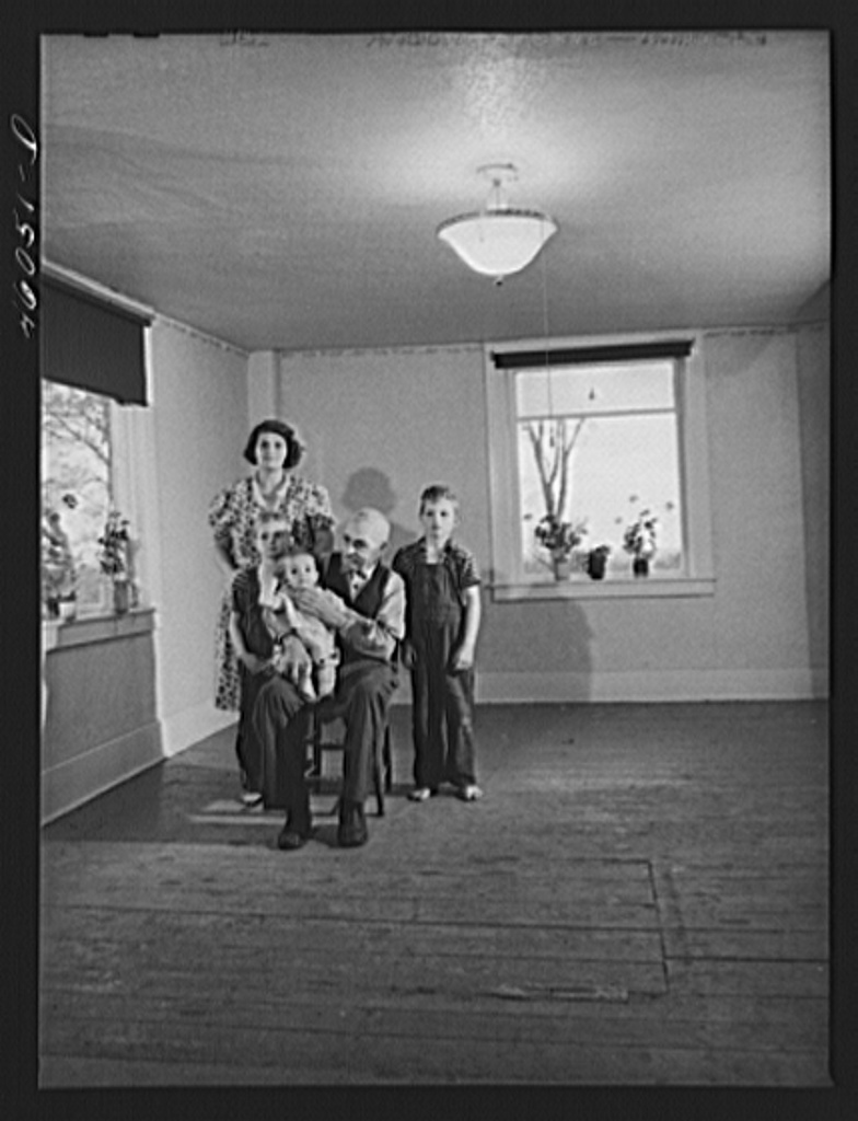 Mrs. Melvin Rivers, some of her children and her father-in-law in their new New York relocation corporation farm to which they have moved just recently, near Orwell, New York