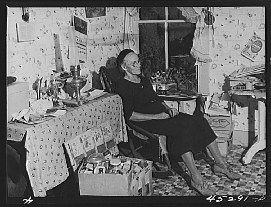 Mrs. Myrtle Higgins of Leraysville, New York, with some of the belongings she has packed preparing to move out of the area being taken over by the Army. Mrs. Higgins has been selling eggs and berries in the town and her son added to her two dollar a week income by working in a junk yard in Watertown, New York. She is moving to a farm near Mexico, New York