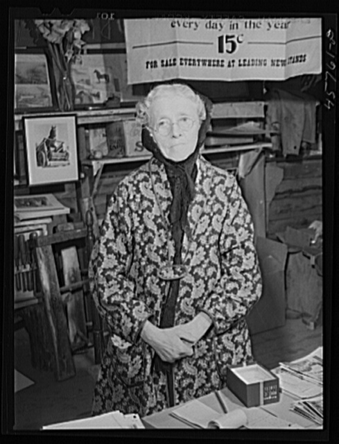 Mrs. Nellie Burroughs of Tunbridge selling pictures and souvenirs at the World's Fair, Vermont