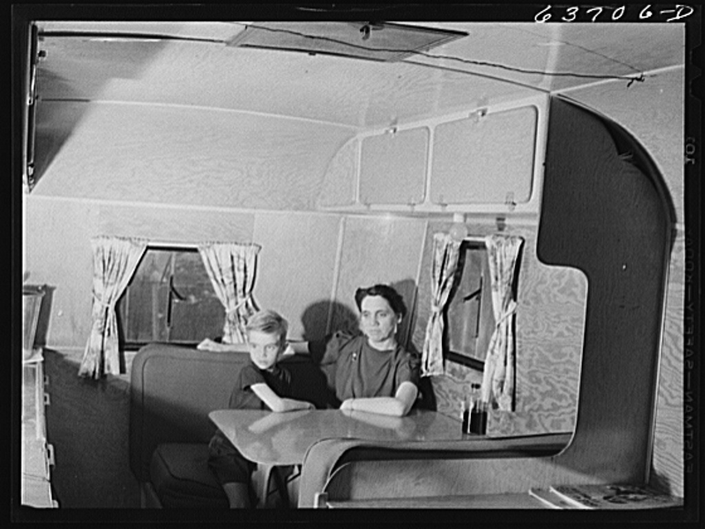 Mrs. Nichols, wife of defense worker, and son, in their trailer home at Edgewater Park near Ypsilanti, Michigan. They are from Casa City, Michigan