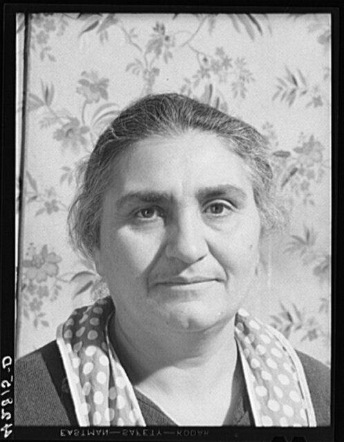 Mrs. Ovegen Arakelian, Armenian, works eleven acres of land with her husband in West Andover, Massachusetts. Their vegetable farm is not enough to see them thru the winter, and their son tries to supplement the family income with work in town when he can get it