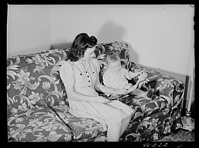 Mrs. Therman N. Ratcliff, defense worker's wife with their daughter, Mary K. Ratcliff, in their living room. Sunset Village, FSA (Farm Security Administration) project, Radford, Virginia