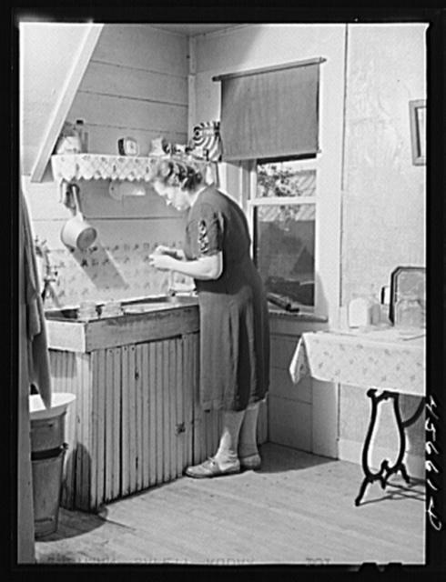 Mrs. W. Gaynor canning tomatoes on their farm near Fairfield, Vermont