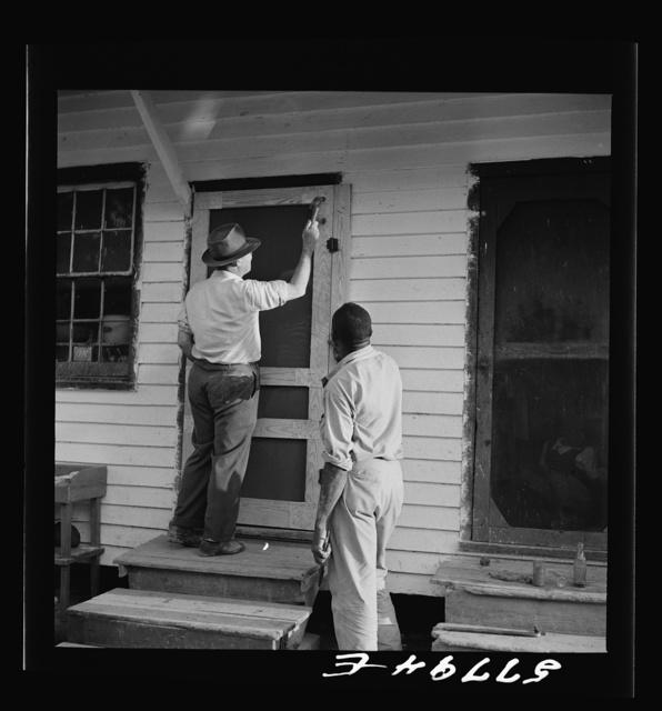 Nailing the hinge strip to the door frame. Saint Mary's County, Ridge, Maryland. Screening demonstration