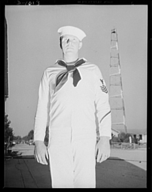 Naval Uniforms. John Marshall Evans, Radioman, first class. Radioman Evans' uniform is the white service dress worn both aboard the ship and at shore station during the summer months or in the tropics. Naval Air Station, Anacostia, Washington, D.C. August 21, 1941