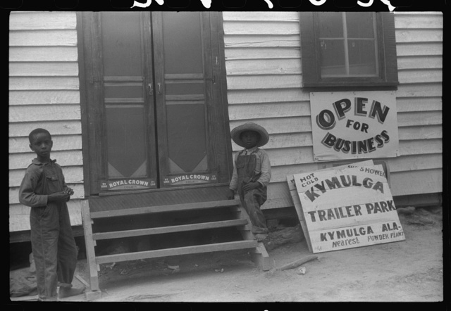 Negro children outside a recently opened lunch room and trailer park in Kymulga near Childersburg, Alabama