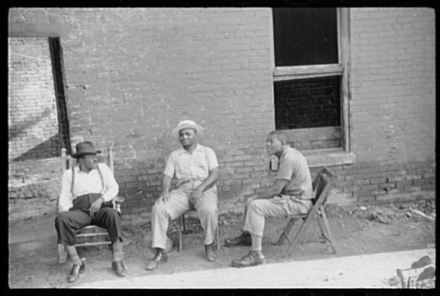 Negroes in front of their homes in the alley dwelling area. Washington, D.C.