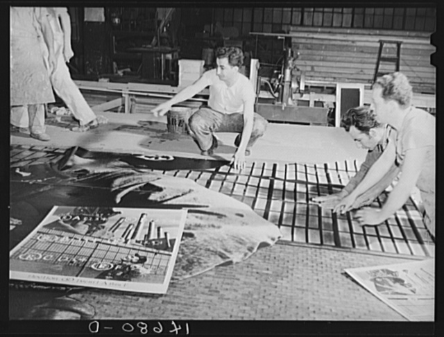 New York, New York. Preparing the defense bond sales photomural, designed by the Farm Security Administration, to be installed in the Grand Central terminal, in the shop of a contractor. Mounting the agricultural panel on homosote board with flour paste