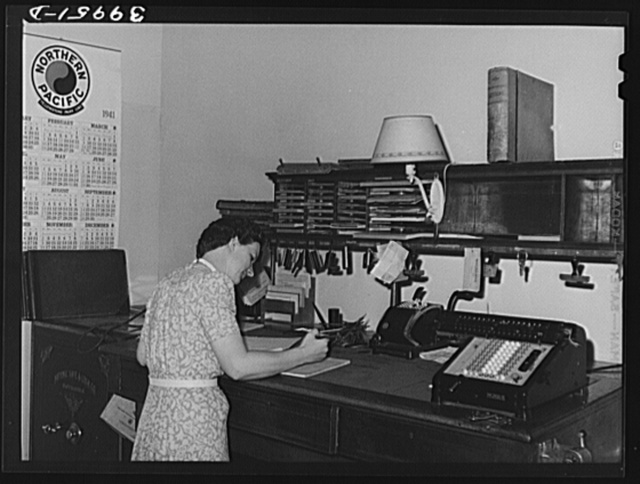 Office worker in wheat broker's office. Whitman County, Washington