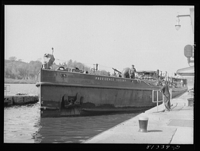 Oil carrier settles in lock as the flood gates are opened. Amsterdam, New York