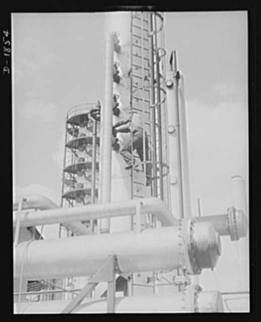 Oil. This is the huge gasoline stabilizing tower of the McKean cracking plant of the Quaker State Refining Company, Bradford, Pennsylvania. Quaker State is one of the many American oil companies working to supply the fuel and lubrication for the war machines of democracy