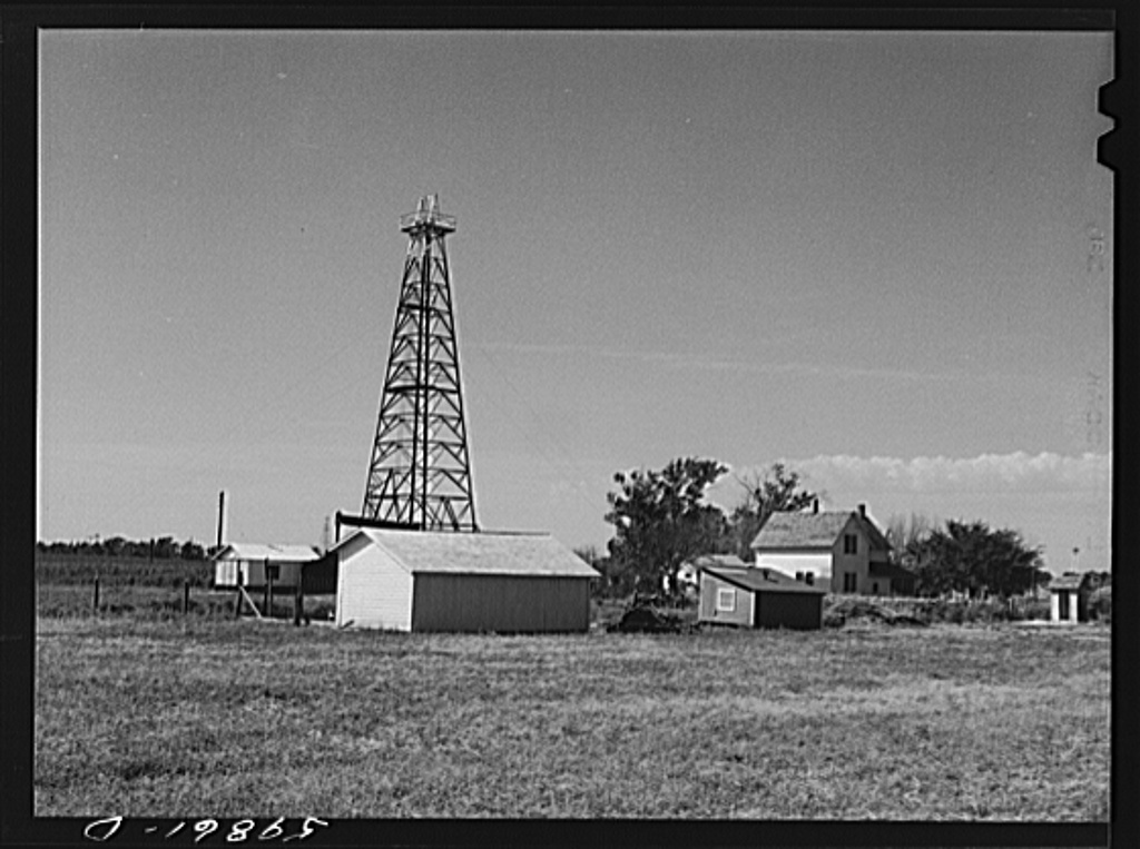 Oil well derrick in farmer's backyard. Goodrich field of Continental oil company. Valley Center Oil field near Wichita, Kansas