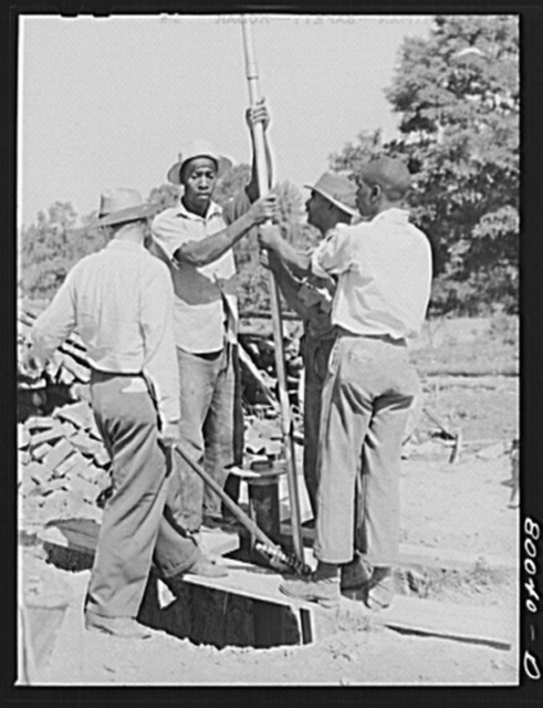 One and a quarter drop pipe ready to be inserted in casing. Safe well demonstration near La Plata, Maryland, Charles County