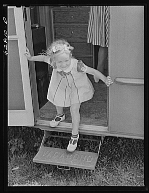 One of Jack Cutter's two children in doorway of trailer home. FSA (Farm Security Administration) camp, Erie, Pennsylvania
