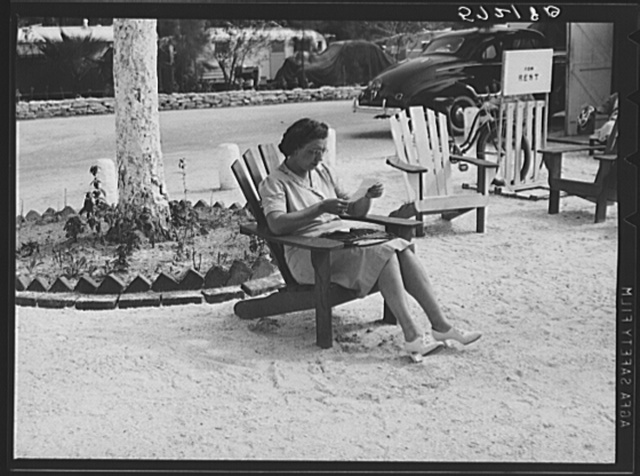 One of the occupants of Sarasota trailer park reading her mail. Sarasota, Florida