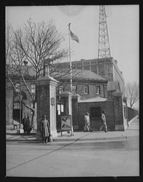 Outpost of democracy's arsenal. Gate of an eastern Navy yard, a well-guarded portal behind which units of Uncle Sam's two-ocean Navy are being rushed to completion