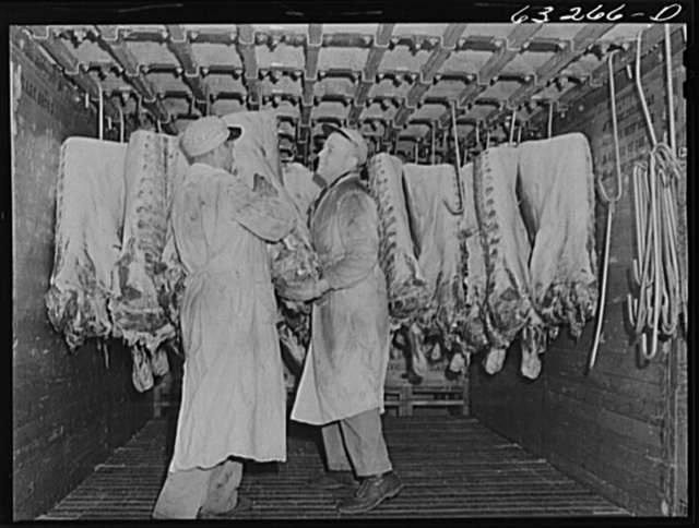 Packing beef into freight car for shipment. Packing plant. Austin, Minnesota