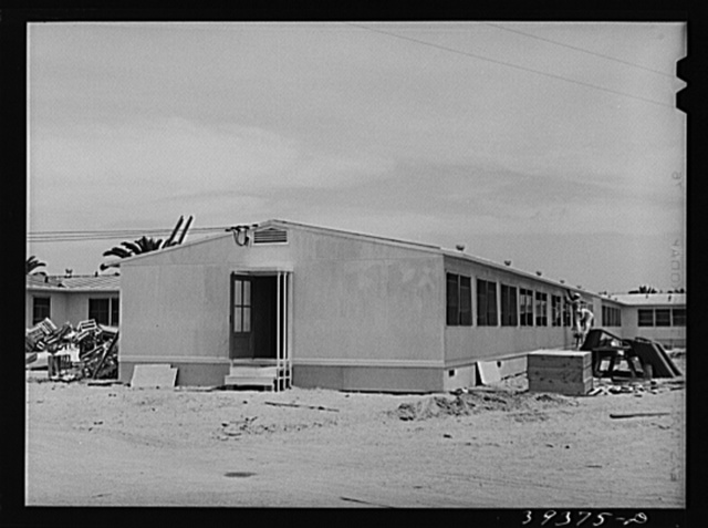 Painters working on dormitories at the FSA (Farm Security Administration) camp for defense workers. Dormitories are being rented to men working in certain specified defense industries and the men must have been living in either substandard housing or who have been commuting long distances to their jobs. San Diego, California