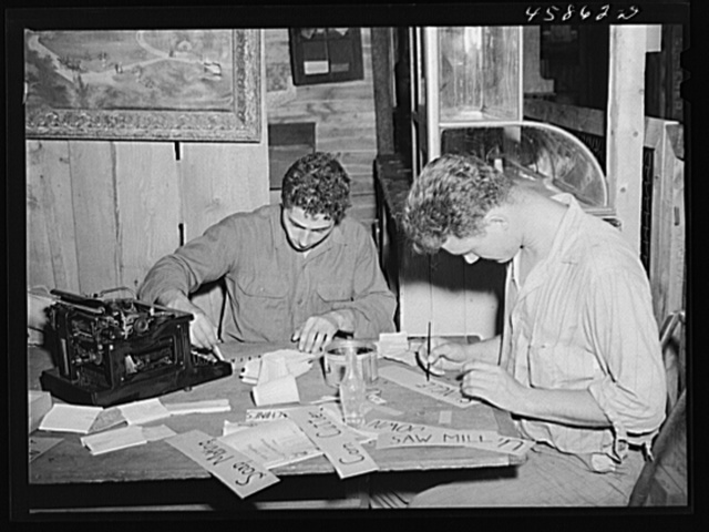 Painting signs for the exhibits at the World's Fair, Tunbridge, Vermont