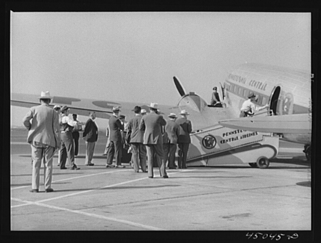 Passengers boarding an airliner. Municipal airport, Washington, D.C.