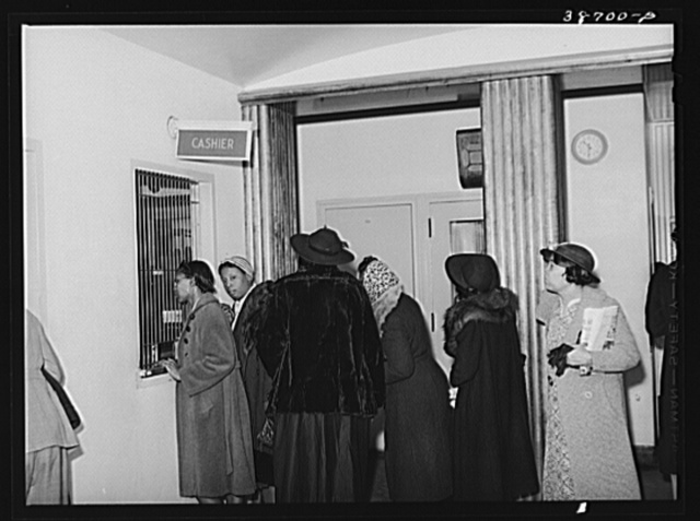 Patients at clinic paying bills. Chicago, Illinois