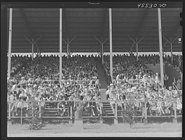 People in the grandstand watching the sulky races at the Rutland Fair, Vermont