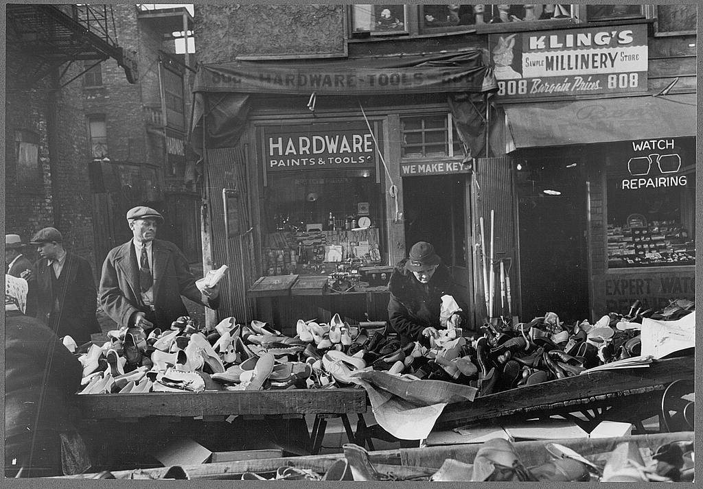 People shopping for shoes at shop on Maxwell Street, Chicago, Illinois