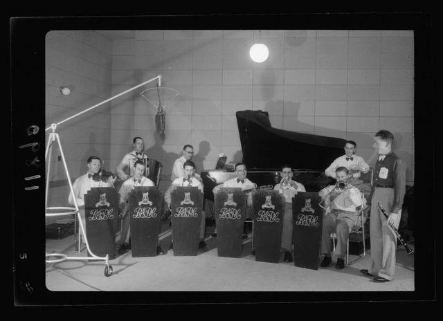 Photo taken in Palestine Broadcasting Service Studios, Jerusalem. Military band in studio, broadcasting, closer