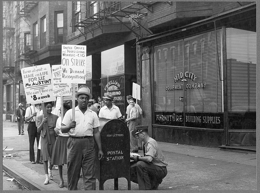 Picket line in front of Mid-City Realty Company. South Chicago, Illinois