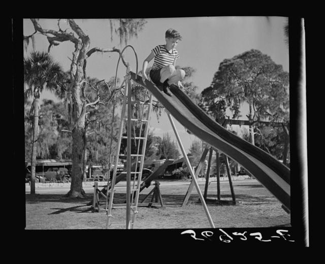 Playing in the playground in Sarasota trailer park. Sarasota, Florida