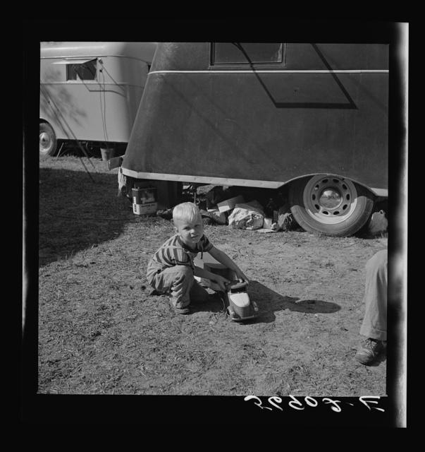 Playing outside trailer home. Sarasota trailer park, Sarasota, Florida