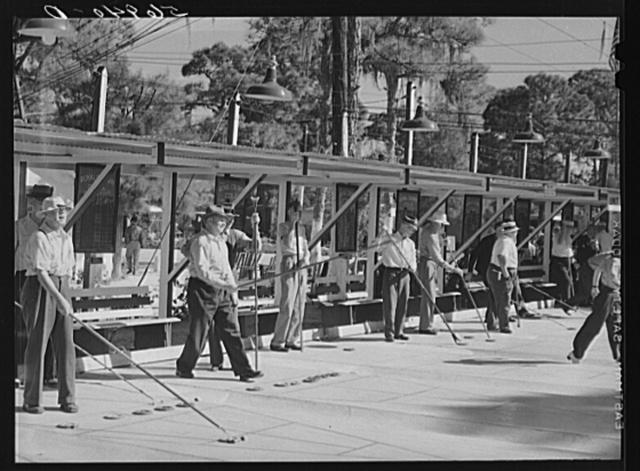 Playing shuffleboard. Sarasota trailer park, Sarasota, Florida