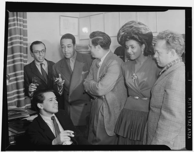 [Portrait of Ahmet M. Ertegun, Nesuhi Ertegun, Duke Ellington, William P. Gottlieb, and Dave Stewart, William P. Gottlieb's home, Maryland, 1941]