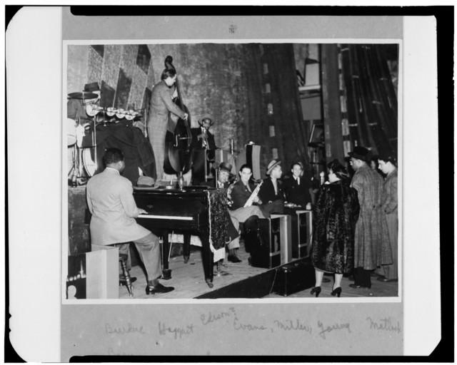 [Portrait of Count Basie, Ray Bauduc, Bob Haggart, Harry Edison, Herschel Evans, Eddie Miller, Lester Young, Matty Matlock, June Richmond, and Bob Crosby, Howard Theater, Washington, D.C., ca. 1941]