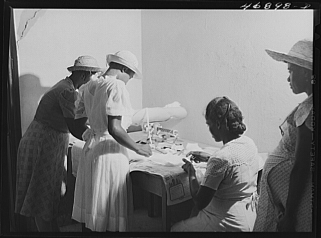 Prederiksted, Saint Croix Island, Virgin Islands (vicinity). Preparing surgical dressings at a health clinic